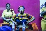 Uganda's Stella Nyanzi bares breasts in protest at jail sentence